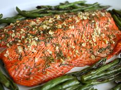 Rosemary and Garlic Roasted Salmon. 3 cloves Garlic 2 sprigs Rosemary, About 1 Tablespoon Chopped 2 pounds Salmon Fillet 1 Tablespoon Extra Virgin Olive Oil 2 pinches Sea Salt 1 pinch Ground Pepper 425 for 10min.
