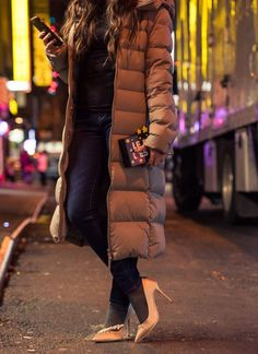 How to Survive Winter in New York City: Black Long Sleeve Tee Shirt, Blue Denim Jeans, Beige Down Puffer Coat, by Uniqlo   coveteur.com