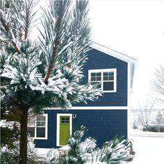 A winter wonderland with a pop of color. @brittany_kitchen's home is not to be missed with a door in Dark Celery 2146-10.