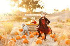 Pumpkin stand. Halloween costume photo shoot.