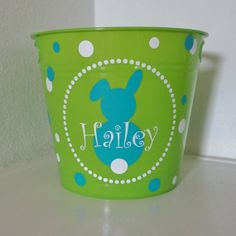 "DIY Easter Basket idea. Perfect on Plastic or Metal. Pictured on a dollar tree bucket. 6"" high circle with bunny inside. Personalize with child's name :)"