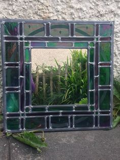 Bespoke and decorative mirror with a green glass border.