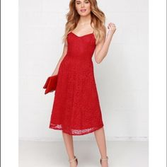 MIDI red lace dress NWOT. Very pretty cutesy lace dress. Hits at knee or mid calf depending on your height. I'm 4'9 and it hits me at mid calf. This is sold out online. Lulu's Dresses Midi