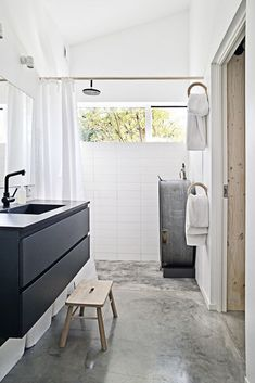 bathroom: polished concrete, black, white, ply + the coolest temporary bath tub i've ever seen!