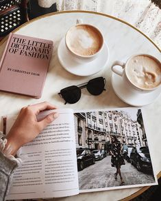 I want this to be me...In a cafe in Vienna with a scientific article and a cell physiology textbook