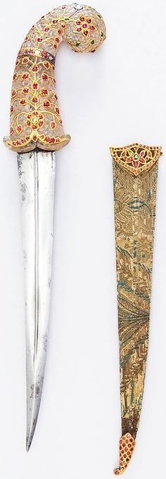 Indian dagger, 19th century, steel, nephrite, gold, emeralds, rubies, diamonds, ray skin, H. with sheath 15 11/16 in. (39.8 cm); H. without sheath 14 5/8 in. (37.1 cm); W. 3 3/8 in. (8.6 cm); Wt. 15.8 oz. (447.9 g); Wt. of sheath 1.8 oz. (51 g), Met Museum.