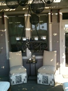 Intimate Outdoor Atmosphere With A Low Hanging Chandelier And Black Spheres That Are LED Lit