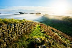Mist envelopes Hadrian's Wall at Cuddy's Crag. Some historians say Arthur fought his last battle nearby © Justin Foulkes / Lonely Planet