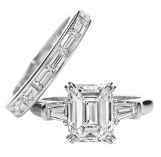 Harry Winston Classic Winston, Emerald-cut Ring. Emerald-cut diamond engagement ring with tapered baguette side stones, featured here in a 2.60 carat center stone, 0.42 carats side stone total weight; platinum setting. Horizontal channel-set bague
