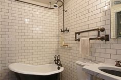 I love the white subway tiles & copper piping towel rack! -- from an article on @Refinery29