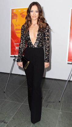Olivia Wilde in a plunging sequin black Michael Kors jumpsuit
