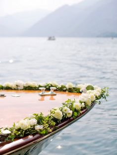 have a romantic paddle boat covered in flowers to ride away in instead of car :)  across the pond:) ha.