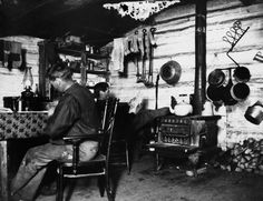 Image No: NA-3961-4 Title: Bruce and Jim Hunter in homestead shack, Dog Pound…
