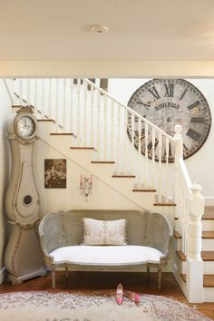 Love both the huge clock on the wall and the grandfather clock...and the sweet bench too!