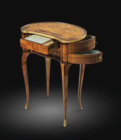A LATE LOUIS XV TULIPWOOD, AMARANTH AND MARQUETRY WRITING TABLE, ATTRIBUTED TO LOUIS PÉRIDIEZ, CIRCA 1770  sold 60,000 Euro