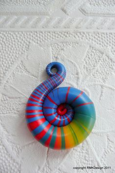 spiral pendant (free tutorial!)  http://www.flickr.com/photos/8989180@N02/