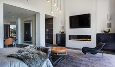 modern mansion - linear gas fireplace with flat screen TV above it Beverly Hills home designed by Kirk Nix purchased by Chrissy Teigen & John Legend - KNA Design via Atticmag decor With TV Above Tv Above Fireplace, Linear Fireplace, Bedroom Fireplace, Open Fireplace, Celebrity Bedrooms, Celebrity Houses, Inside Celebrity Homes, Contemporary Fireplace Designs, Best Electric Fireplace