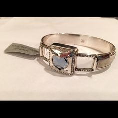 Brighton Blue Open Hearted Hinged Bangle NWT BRAND NEW Brighton Open Hearted Hinged Bangle with a Blue Denim Heart Swarovski Crystal.  NWTHas Clasp w/Hook Closure.  Nice width at 3/4 inches. Diameter is 2+1/4 inch. BRAND NEW, never even been tried on!  It has a Dust Bag and the Tag on it.  Still available on their website for $88.  Great Gift  NO TradesPRICE IS ABSOLUTELY FIRM $31 off of Retail! Brighton Jewelry Bracelets