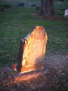 A picture I took in a local cemetery. The sun was setting, and this was the only grave that was still lit up. - DFW-Haunted.com