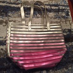 Pink and Gold Striped Tote Pink and gold striped tote. I think I got this from Victoria's Secret as a gift a while ago. I've had it in storage. You can see the plastic tag piece is still on it, but I can't see where it says VS, so I'm not 100% sure. Large tote- 14 by 19.5 inches. No flaws or stains. Feel free to ask any questions or make an offer. Victoria's Secret Bags Totes