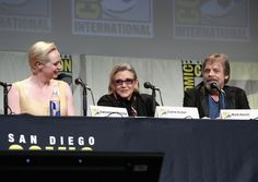 """Carrie Fisher and Gwendoline Christie Photos Photos - (L-R) Actors Gwendoline Christie, Carrie Fisher and Mark Hamill at the Hall H Panel for """"Star Wars: The Force Awakens"""" during Comic-Con International 2015 at the San Diego Convention Center on July 10, 2015 in San Diego, California. - Star Wars: The Force Awakens Panel at San Diego Comic Con - Comic-Con International 2015"""