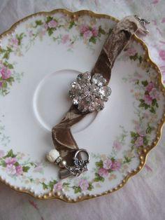 Velvet ribbon bracelet, vintage brooch and beads.