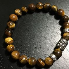 NEW Lucky Buddha Tiger Eye Lava Stone Bracelet Tigereye is beneficial for health & spiritual well-being. Helps keep you balanced, focused, centered & grounded. It is said to bring good luck.  Lava Stone is a very powerful energy crystal and throughout history has been used as an amulet of protection when engaging into battle. Lava stone is a grounding stone that helps us connect to the energies of Mother Earth and the element of Fire. It can help to dissipate anger and absorbs negative…