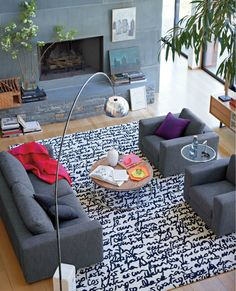 Lovely rug, saw a similar one at http://www.caravanrug.com/. Grey couch + chairs + graphic rug + floor lamp. (Bonus points for lofted ceiling)