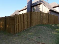 how to build a picket fence on a slope