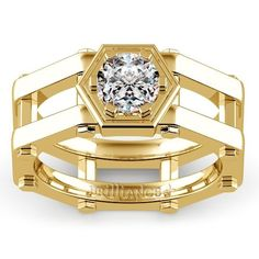 Daedalus Solitaire Mangagement™ Ring in Yellow Gold - Daedalus is a symbol of hard work and strength, just like the commitment of one person to another. A nuts and bolts design spans across the finger, holding the 1 carat center diamond, prong set on a cog-inspired design. Mangagement™ by Brilliance. Design by Dehlia Sprague, GIA G.G.