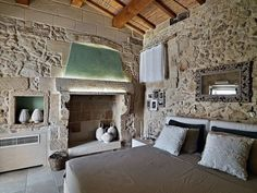 The Relais Masseria Capasa is a stunning hotel located in Martano, Italy. Originally constructed in the century, the property was renovated by Paolo Fracasso in Photos courtesy of the Relais Masseria Capasa Share your Thoughts House Design, House, Interior, Home, Bedroom Design, Rustic Stone, Interior Design, Stone House, Rustic Interiors