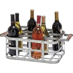 """Metal basket wine holder. Holds 12 bottles. Metal basket wine holder. Holds twelve bottles.     Product: Wine holder    Construction Material: Metal Color: Weathered silver    Features:   Charming design   Holds twelve wine bottles       Dimensions: 6"""" H x 16"""" W x 12"""" D    Note: Not recommended for outdoor use   Cleaning and Care: Wipe with dry cloth"""