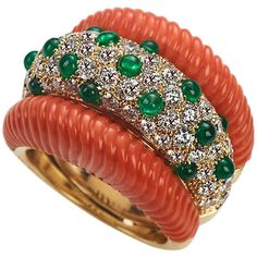 Veschetti Coral emerald diamond gold ring   From a unique collection of vintage band rings at https://www.1stdibs.com/jewelry/rings/band-rings/