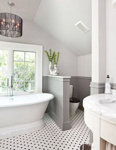 Gray and white bathroom. Claw foot tub. Jess--this reminds me of what you were talking about for your bathroom:)