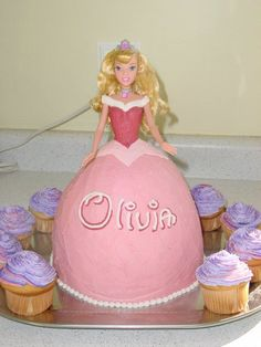 Sleeping Beauty Wonder Pan - My first Wonder Mold Pan cake, used store bought doll.  I had to make one 8' round layer to add to the bottom so the entire doll would fit.  Frosted only in Wilton recipe buttercream (8 cups).  Added Raspberry flavoring and it was excellant.  For presentaion sake, the next Wonder mold I make, I will layer the inside to match the 8 inch round I added.  The cake would have looked more appealing after it was cut if it had layers of frosting inside.