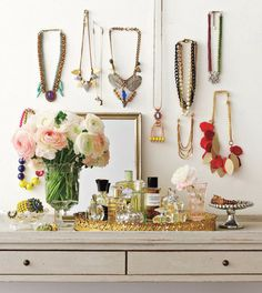 LOVE this idea. i am trying to minimize some things in my possession right now, jewelry bieng the hardest upcoming one. individually hanging each necklace really prevents a pile up of unworn jewelry! and it's pretty. : )