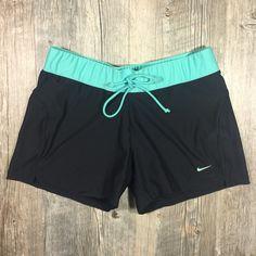 Nike black and mint green shorts Nike black and mint green shorts. Drawstring waist 11 1/4 inches long. 4 inch inseam. Polyester 12% spandex.  Tag reads medium. Nike Shorts