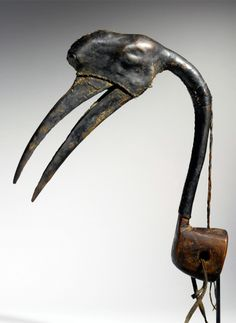 Africa | Hunter's headdress from the Hausa people of Nigeria | Wood, animal beak, leather and natural fiber