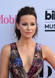 Kate Beckinsale Photos Photos - Actress Kate Beckinsale arrives for the 2017 Billboard Music Awards at the T-Mobile Arena on May 21, 2017 in Las Vegas, Nevada. / AFP PHOTO / MARK RALSTON - 2017 Billboard Music Awards - Magenta Carpet