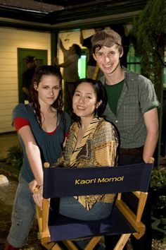"""Kristen Stewart, Kaori Momoi (she portrays the motel owner), and Eddie Redmayne in a photo on the set of """"The Yellow Handkeirchief""""....."""
