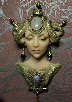 Brooch 'The alien'. Brooch manual molding with agate and charoite