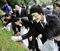 Anonymous Picks Up Litter As Alternative Method Of Protesting