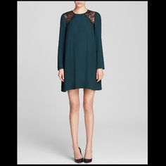 Authentic Sandro Paris lace insert dress Brand new , still with the tag . Dark green color , size 2 would fit size XS-S Sandro Dresses