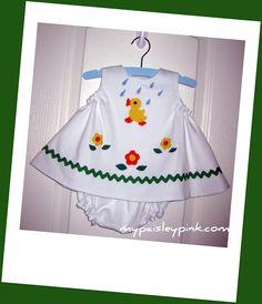 Harper's new dress- Children's Corner Frannie pattern, Ellen McCarn Applique.  Blue pindot picque fabric.