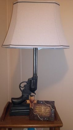 Gun lamp for baby cowboy themed room
