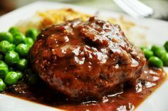 Homemade Salisbury Steak is an easy comfort food dinner! Made with homemade ground beef steaks and covered in the best mushroom gravy, this is a hearty meal the whole family will love. Beef Dishes, Food Dishes, Main Dishes, Best Salisbury Steak Recipe, Salisbury Steak Recipe Pioneer Woman, Salisbury Steak Recipe With French Onion Soup, Easy Salisbury Steak, Meat Recipes, Cooking Recipes