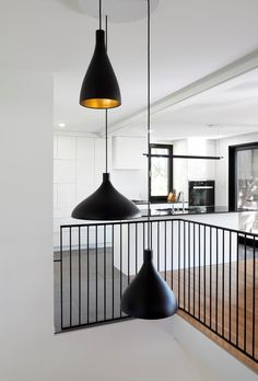 PARKA Architecture has renovated a modernist home in Quebec City, preserving its most successful features while bringing in more natural light and decluttering the interiors. Stair Railing Design, Stair Handrail, Balcony Railing, Banisters, Interior Lighting, Interior Styling, Architecture Design, 1960s House, Interior Stairs