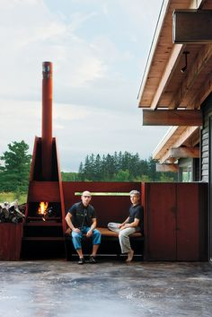 S.J. Sherbanuk (left) and James Campbell sit by the outdoor fireplace, which adjoins the screened-in porch. Photo by: Lorne Bridgman | Read more: http://www.dwell.com/articles/scrap-house.html