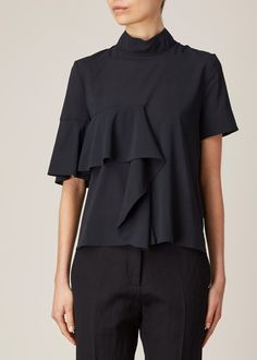 Short-sleeved mock neck ruffle front top in black stretch silk georgette. Draped ruffle embellishment at front. Hidden zip closure at back of neck. Fashion Details, Fashion Tips, Fashion Design, Mode Top, Black Ruffle, Refashion, Shirt Blouses, Blouse Designs, Style Me