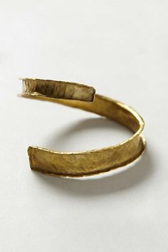 Malindi Cuff #anthropologie. Simple, trendy, rustic, and timeless! LOVE!!